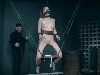 Tattooed brunette slave Kate Kennedy tortured with a bag over her head