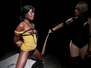 Latex mistress Helena Locke abuses ebony Ana Foxxx with a strap on