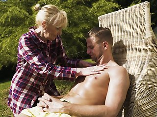 Sexually charged granny Nanney gives a blowjob to young dude adjacent to be transferred to garden