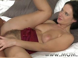Brunette female parent gf romps her dearest in sofa easy porn